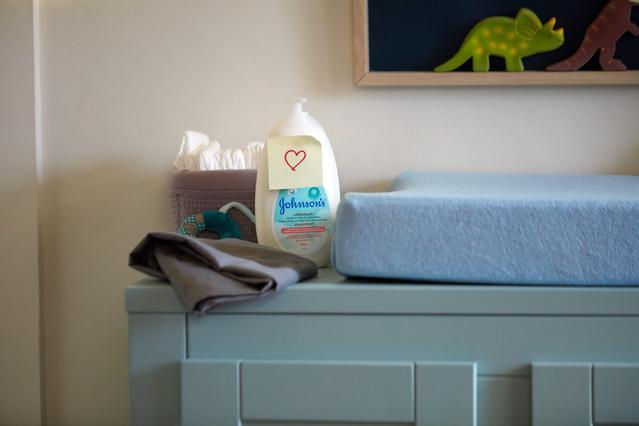 Johnson's® CottonTouch™ newborn lotion on changing table
