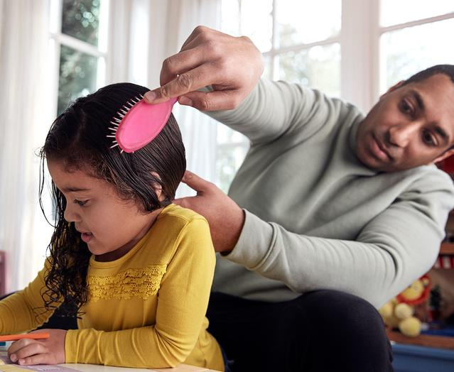 Father Combing toddler hair
