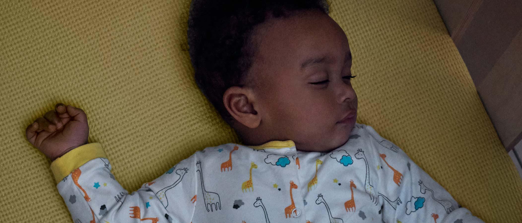 Baby Sleeping in a Wooden Crib