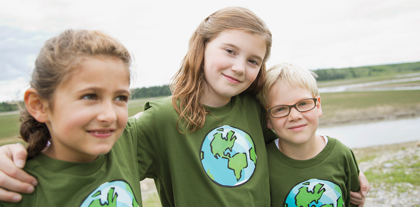 Three girls in environmental earth green shirts